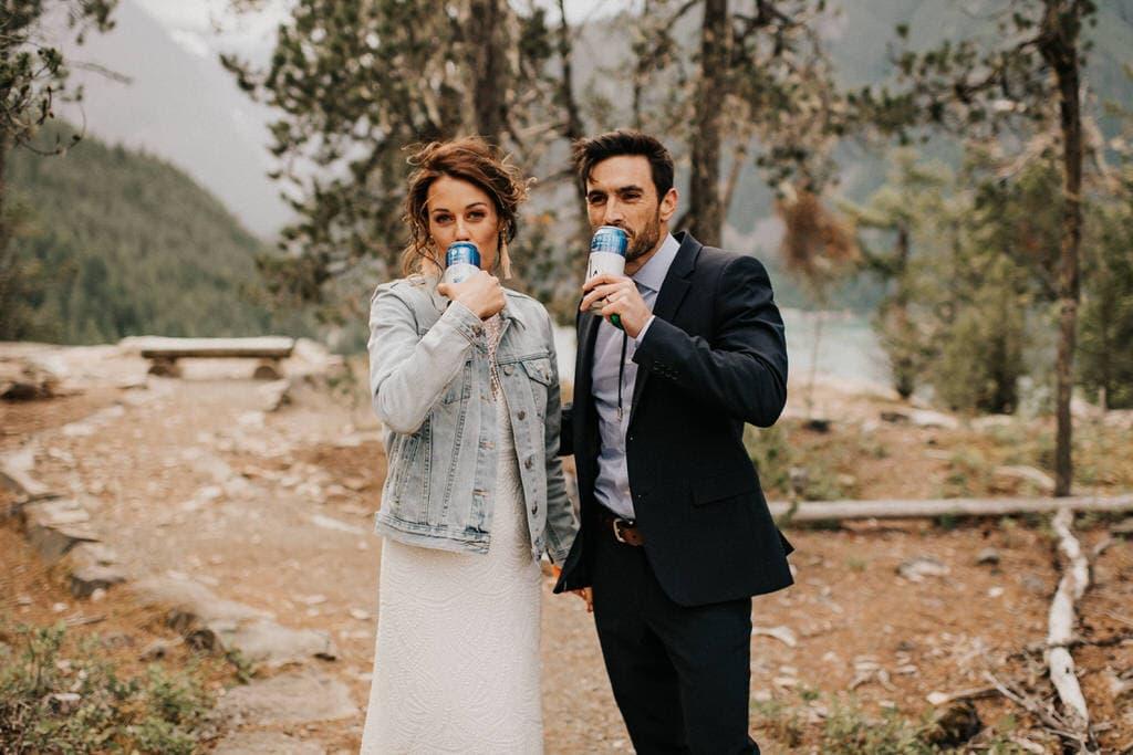 bride and groom drinking beer to celebrate their diablo lake elopement