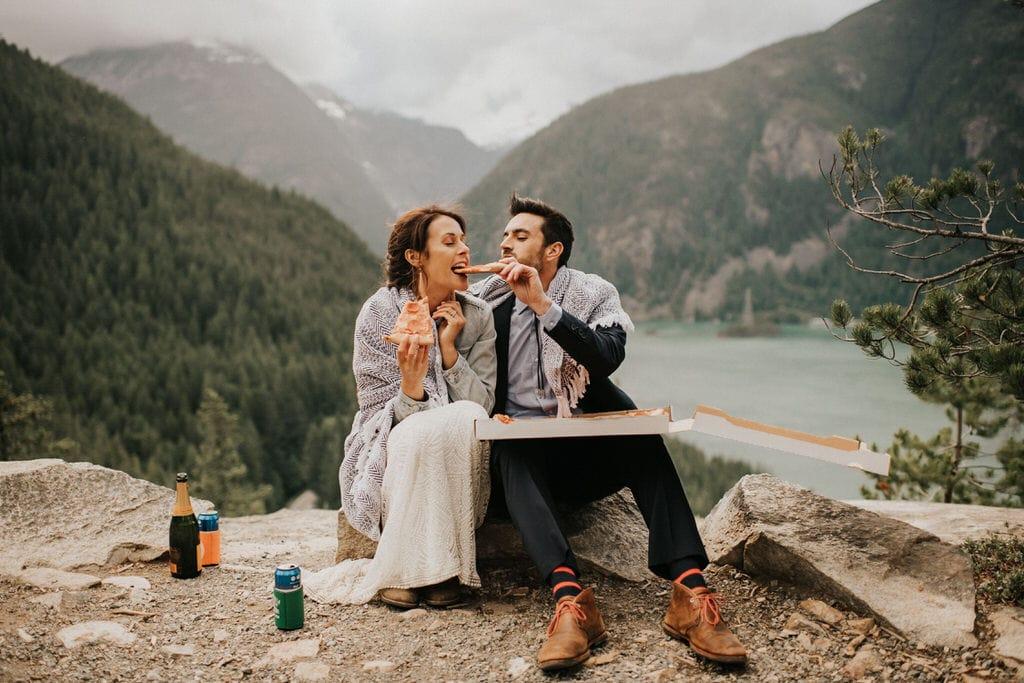 groom feeding bride pizza after diablo lake elopement