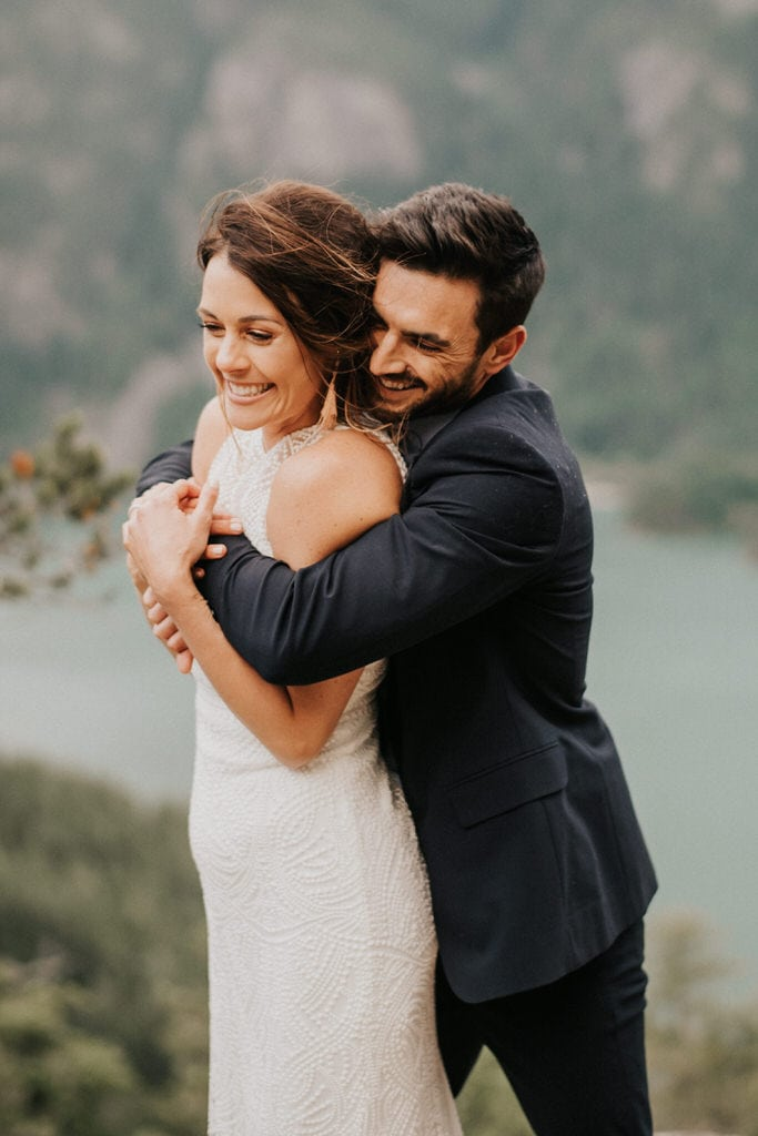 groom hugging bride at wedding