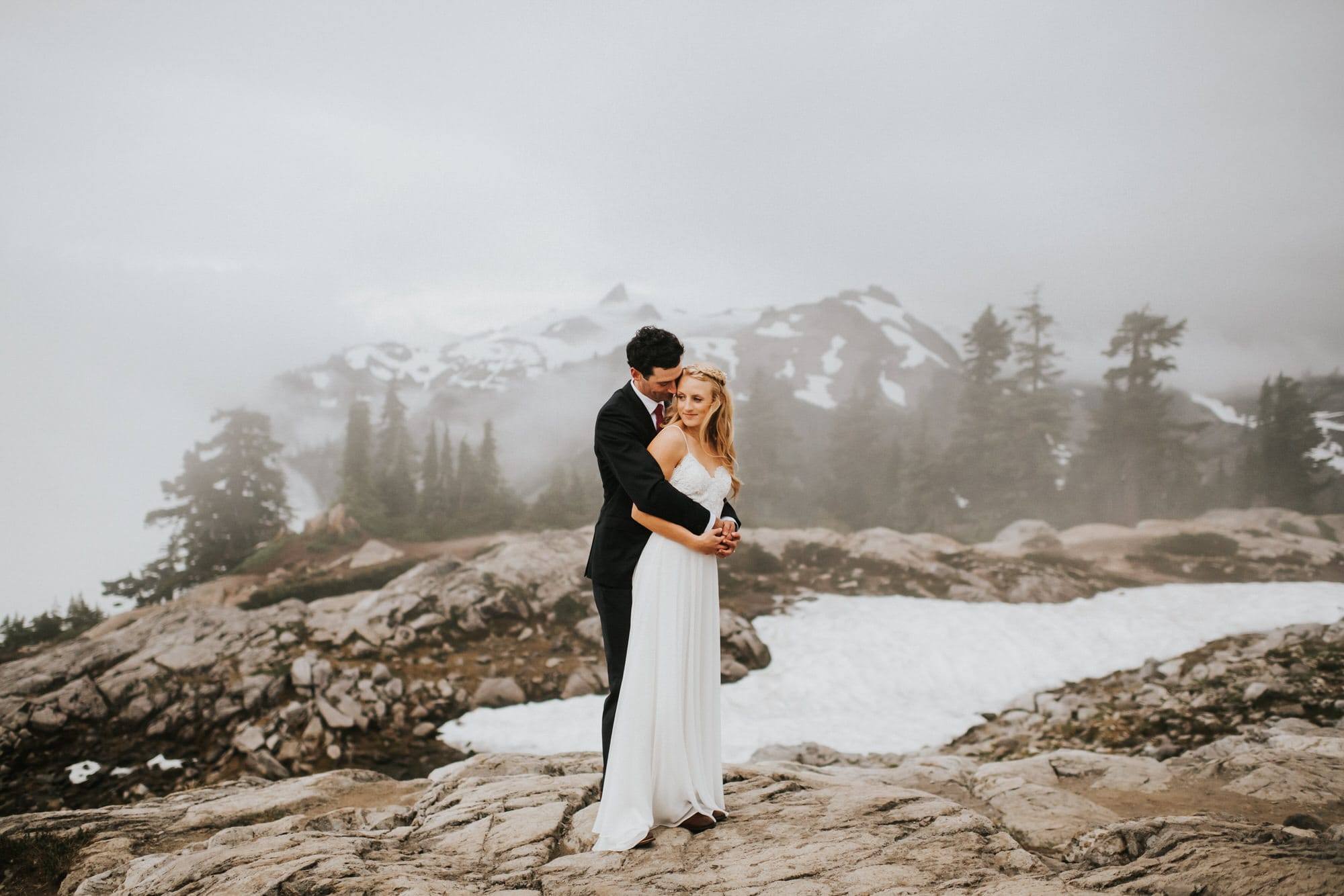 bride and groom at artist point in the fog