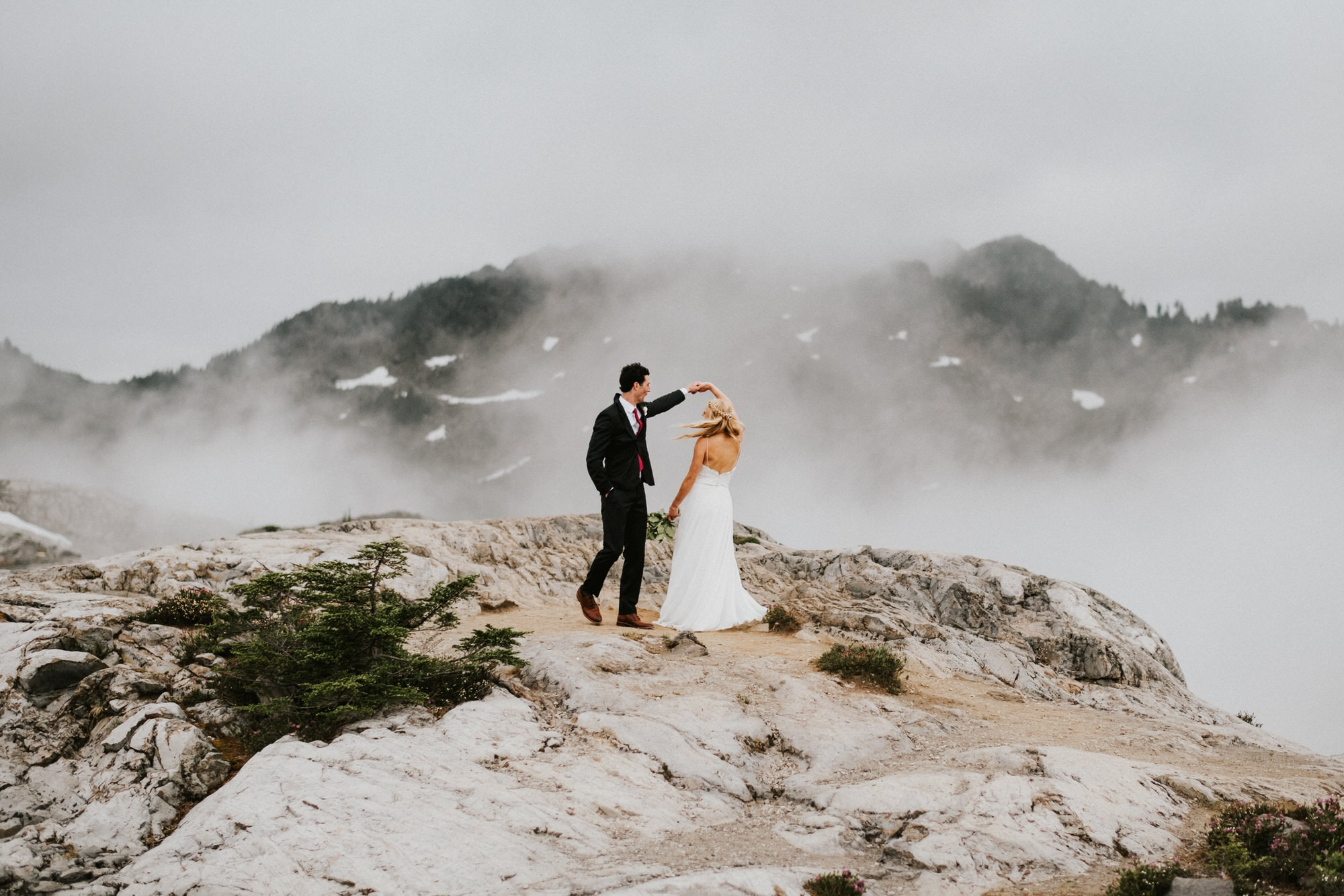 groom dancing with bride on a Washington mountaintop