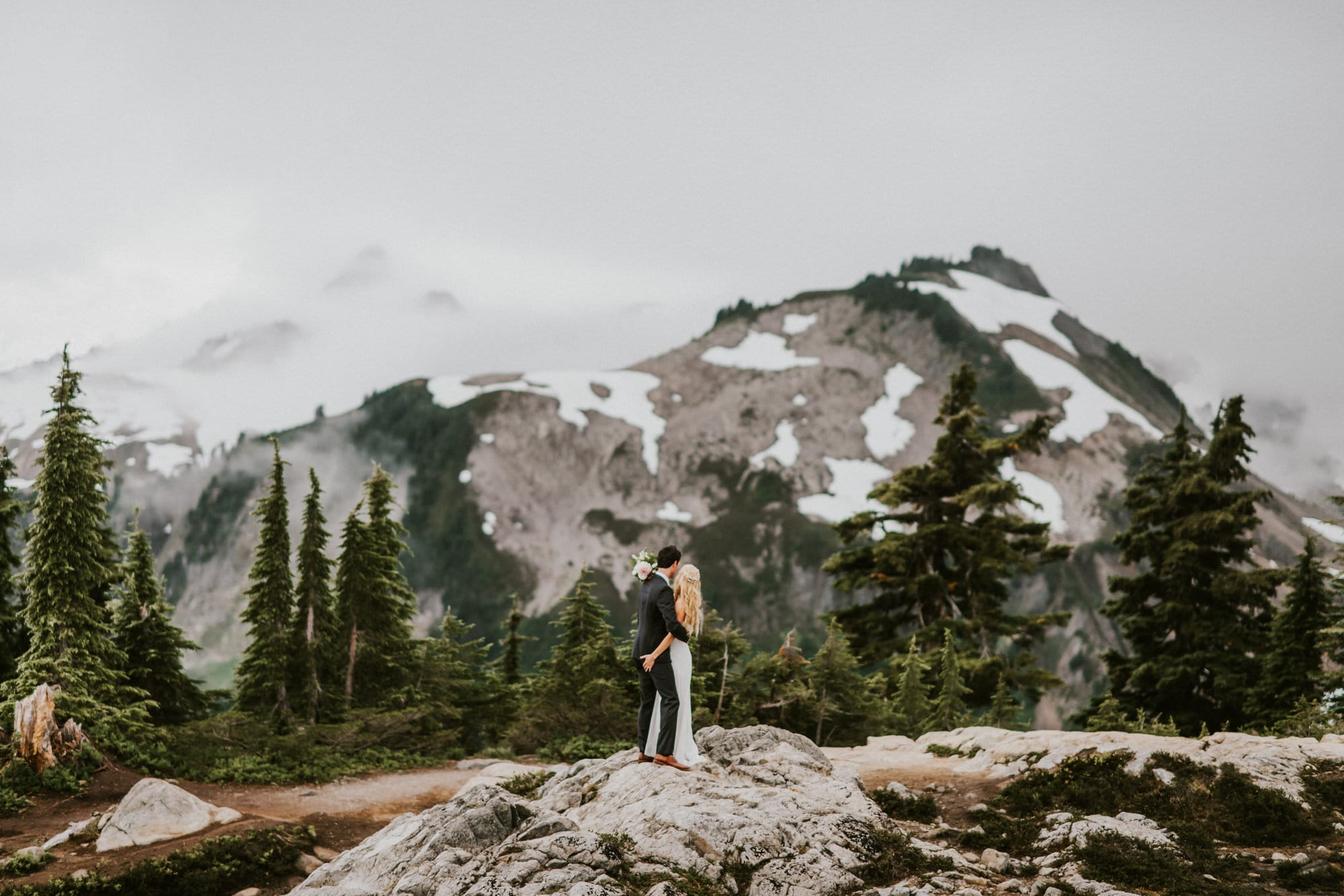 bride and groom looking towards mt baker