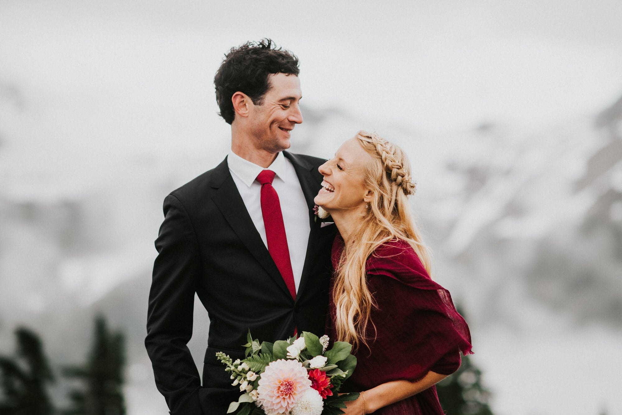 bride and groom laughing together before intimate wedding