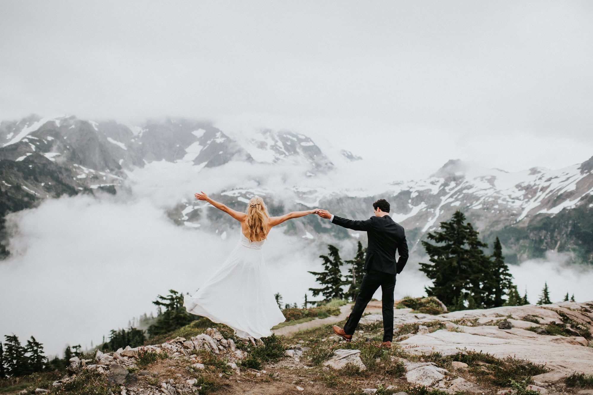 bride and groom feeling like they are on top of the world