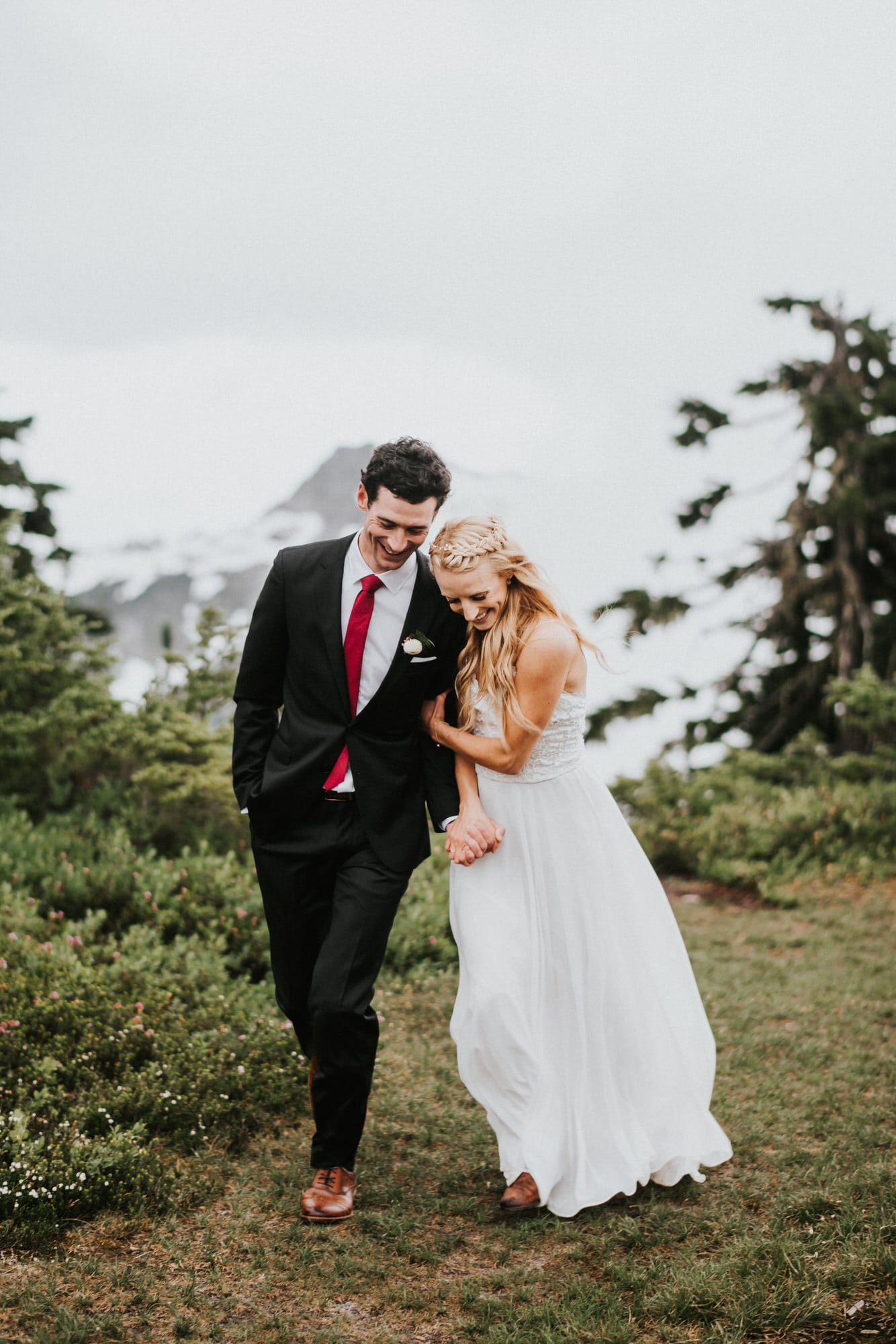 bride and groom being playful at artist point