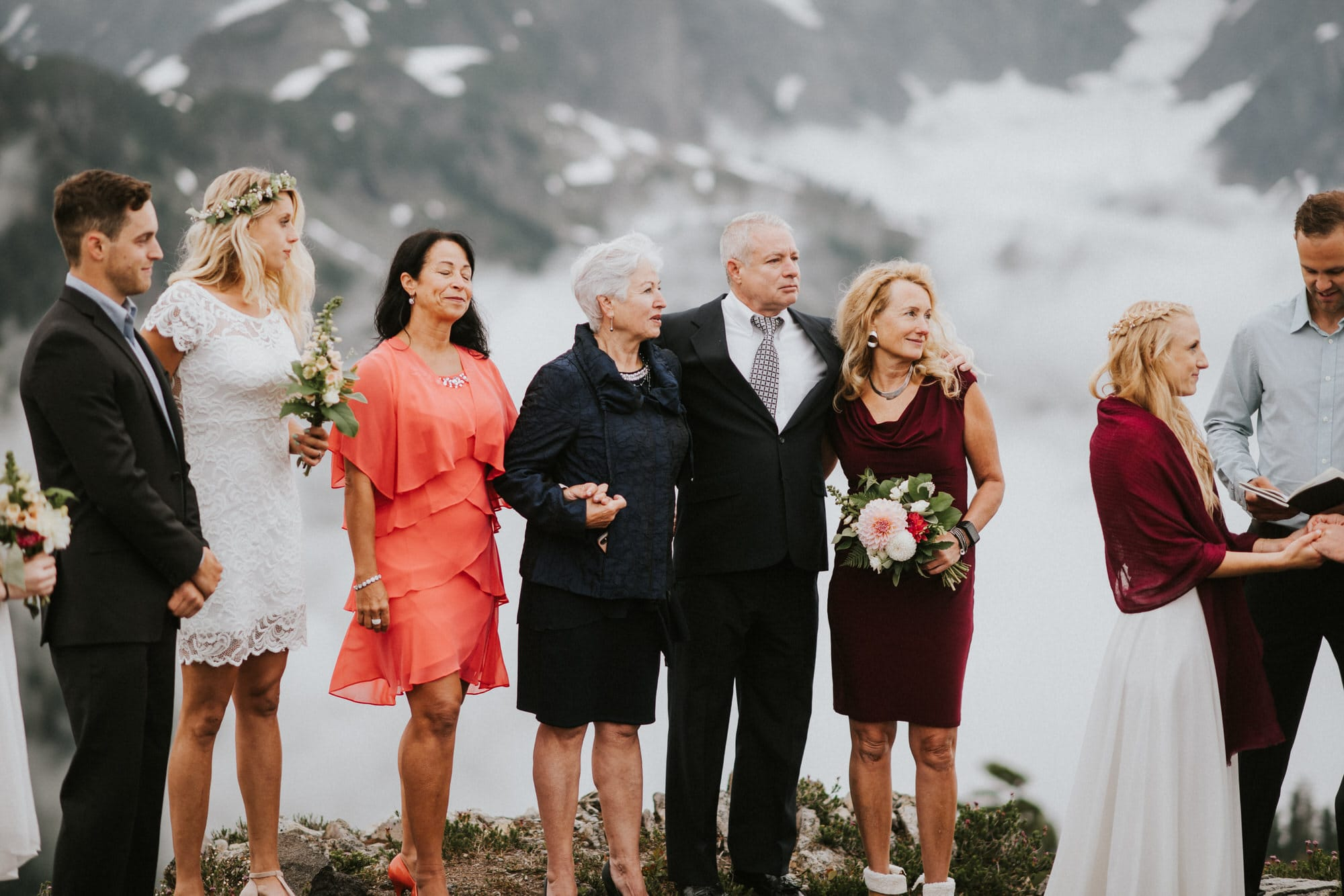 brides family staying warm at outdoor wedding ceremony