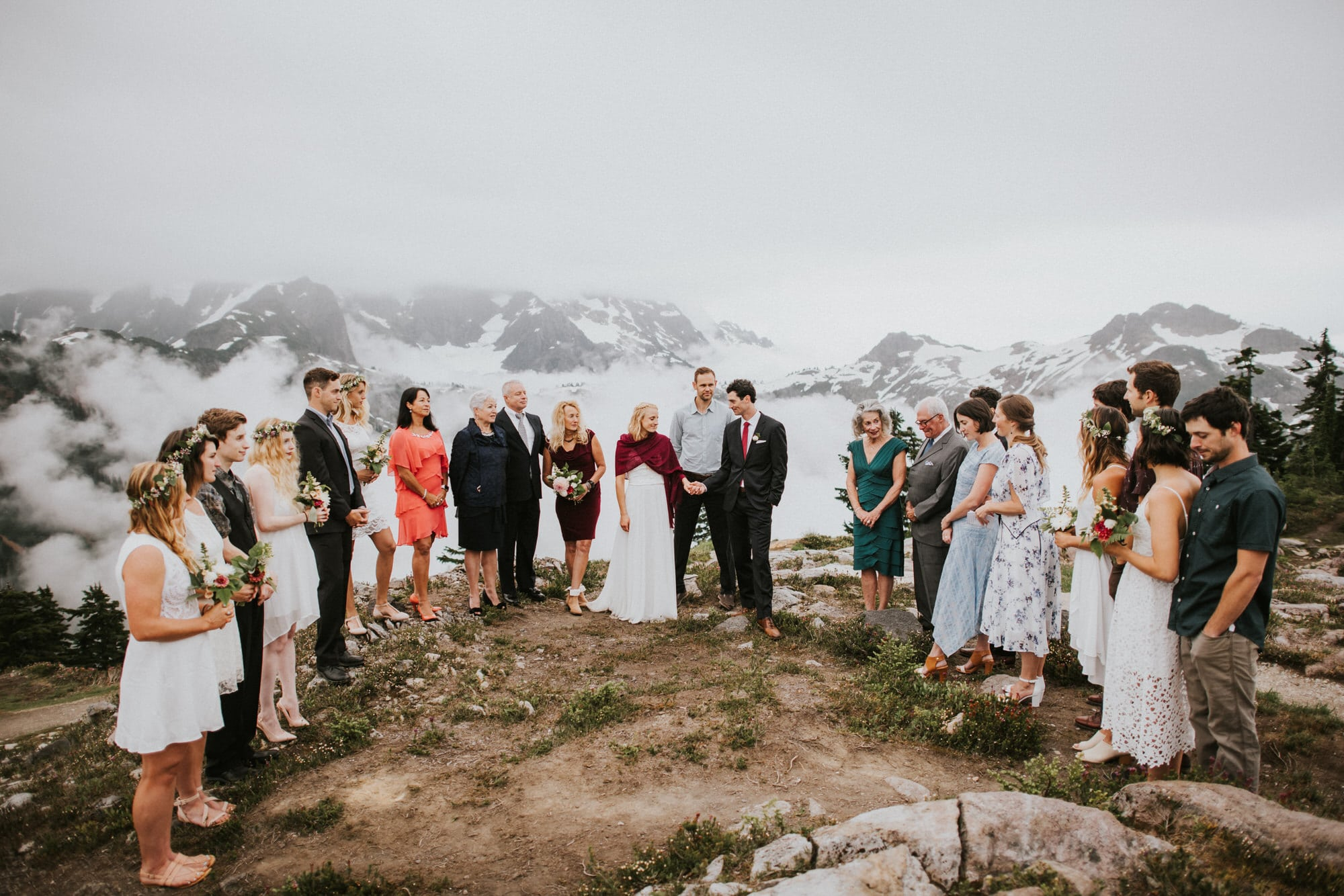 bride and groom with all wedding guests at artist point