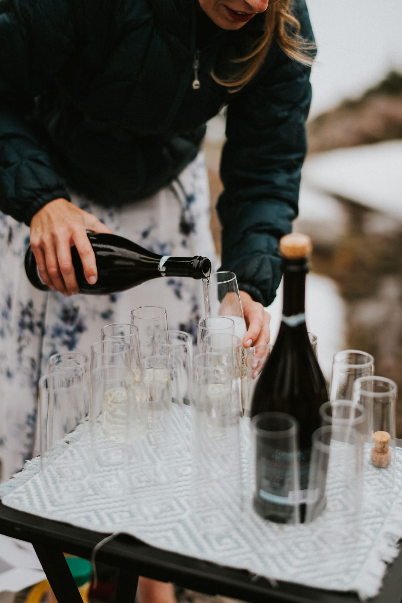pouring champagne after North Cascades Intimate Wedding