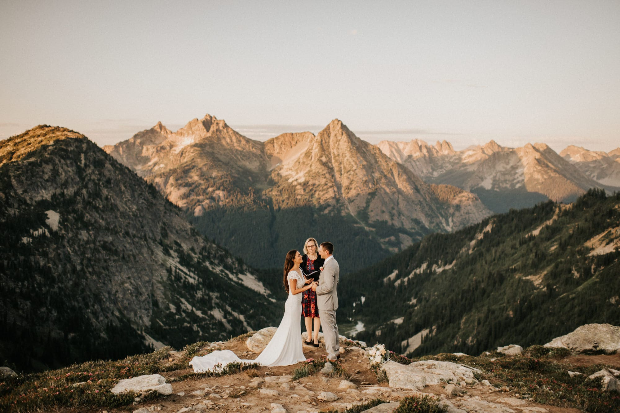 Bride and groom holding hands during north cascades elopement