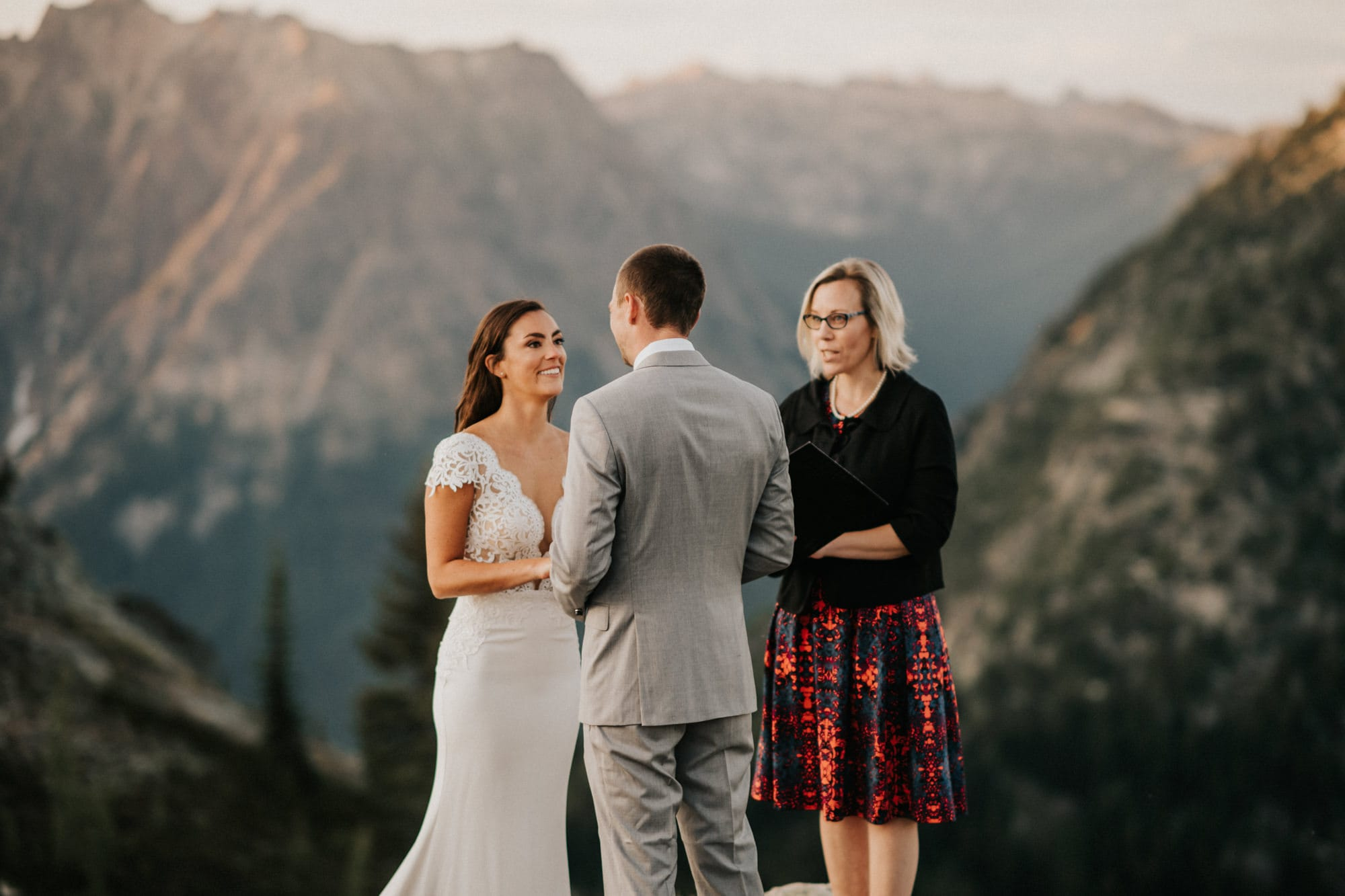 bride smiling at groom during elopement in the mountains