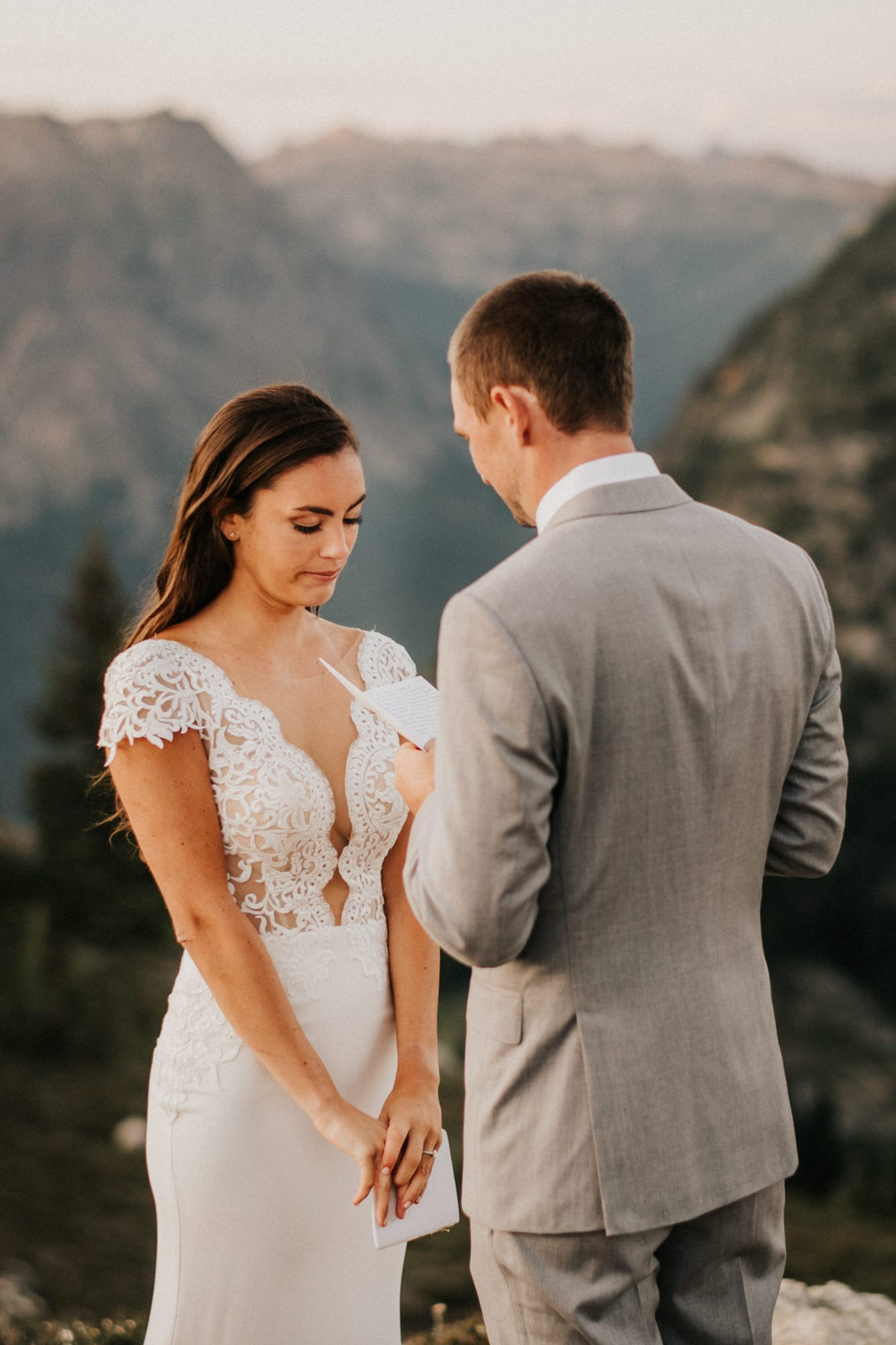Groom reading vows to bride during their north cascades elopement