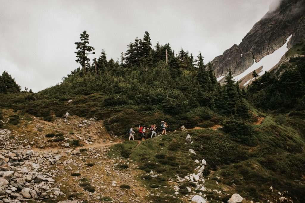 Wedding party hiking to a North Cascades Adventure Wedding