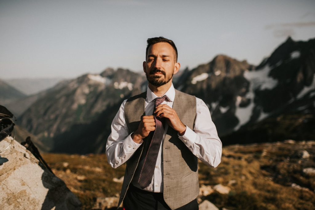 groom getting ready for his north cascades adventure wedding