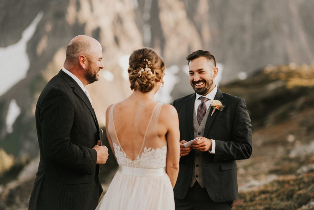 Groom laughing during elopement ceremony