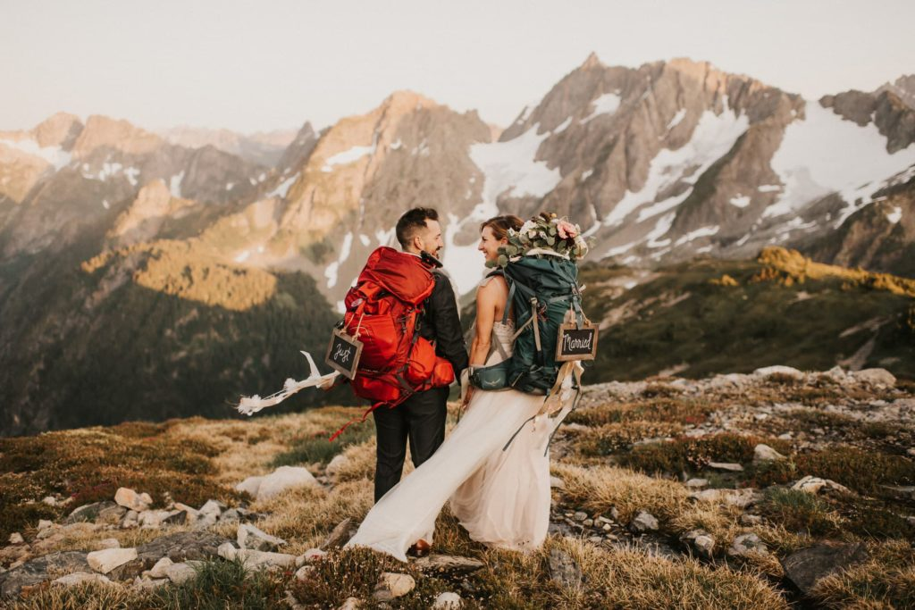 couple hiking together in the washington mountains