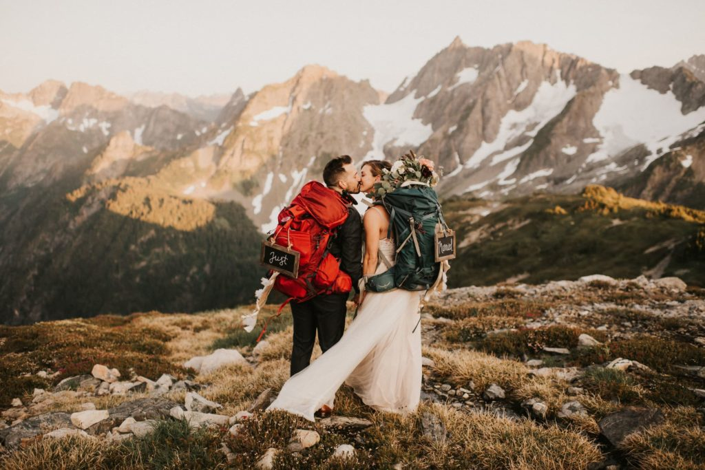Bride and groom kissing after their north cascades adventure wedding