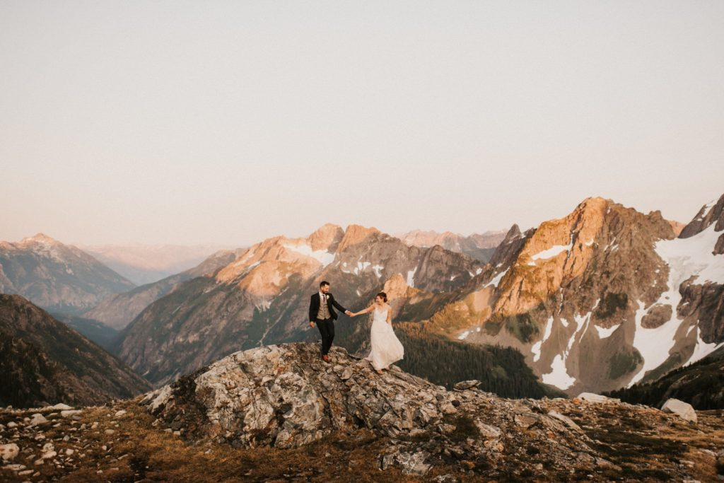 Bride and groom hiking together during their North Cascades Adventure Wedding
