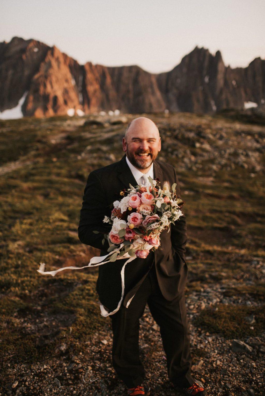 Elopement Officiant holding brides flowers