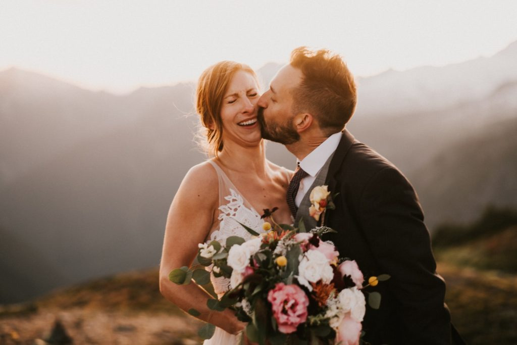 bride and groom kissing in the north cascades