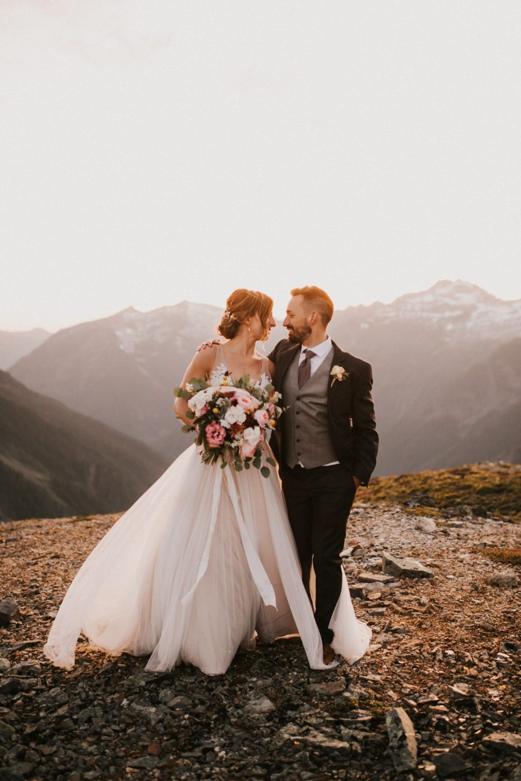 Bride and groom walking to together in the North Cascades