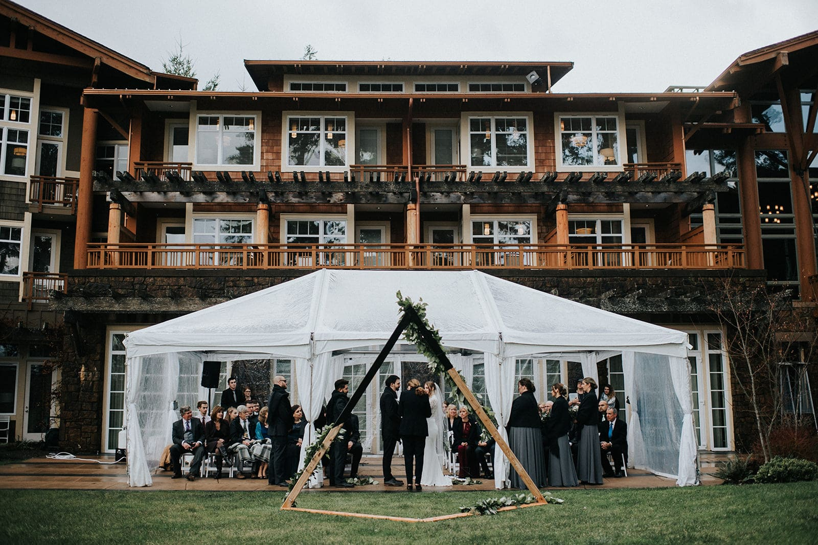 rainy tented wedding ceremony at alderbrook