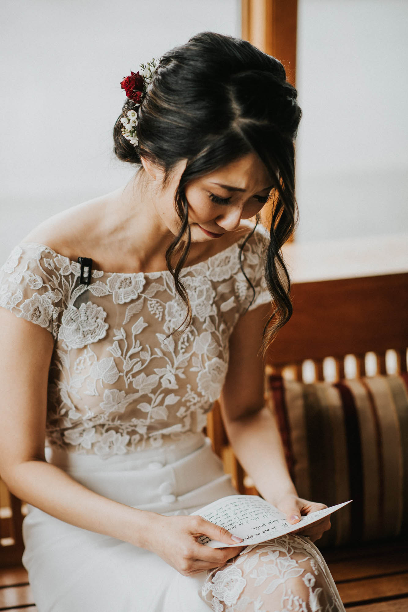 bride crying while reading grooms letter
