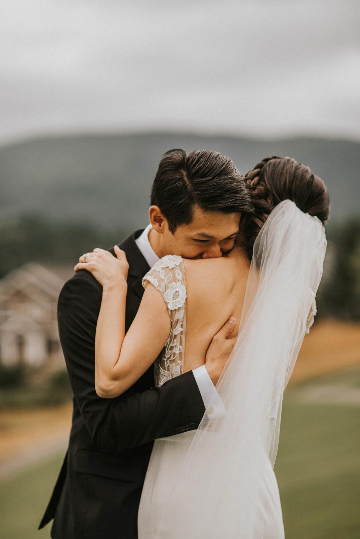 bride and groom hugging