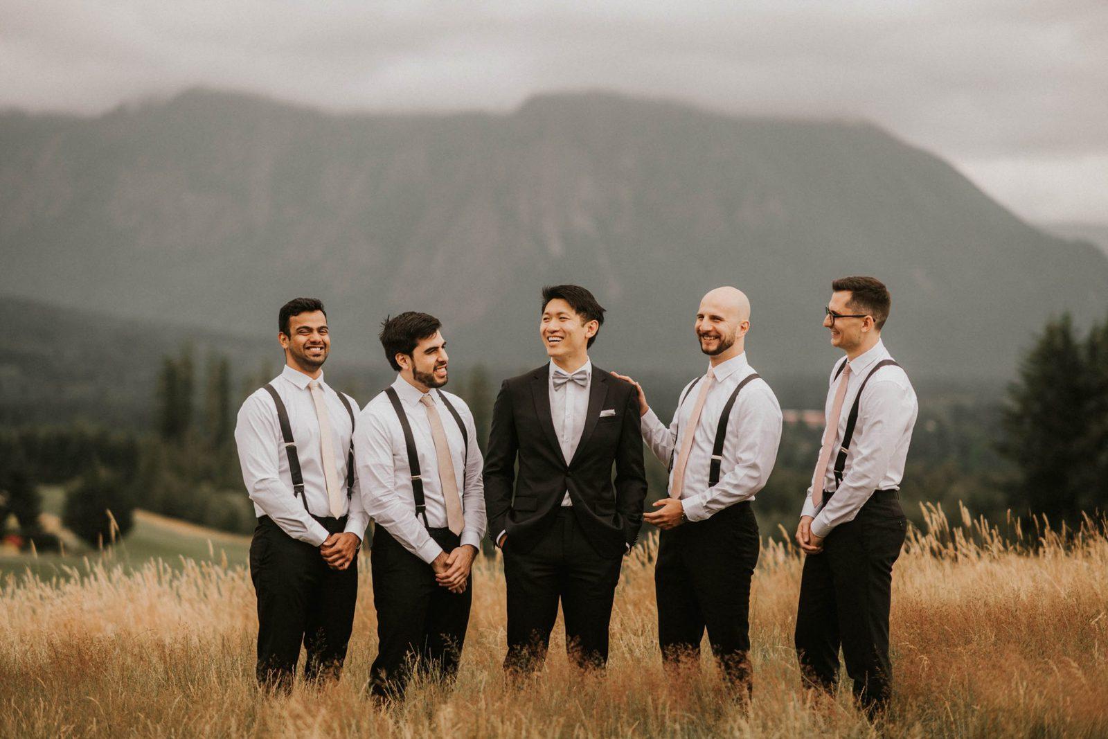 groom and groomsmen laughing
