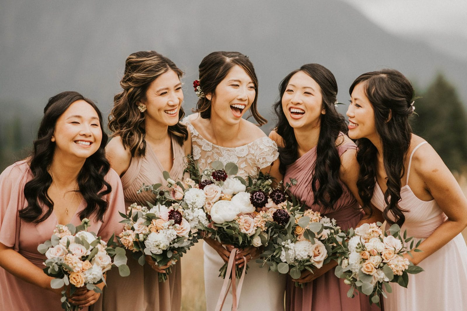closeup of bridesmaids looking at each other and laughing