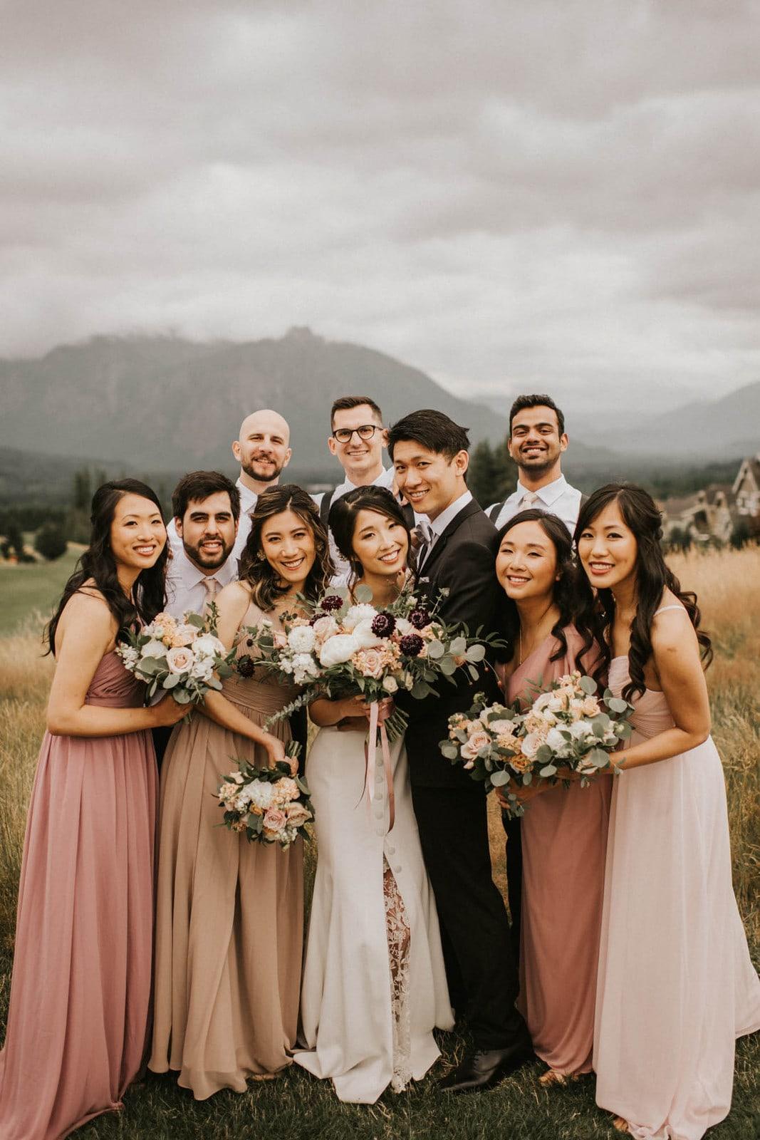 bridal party looking at the camera