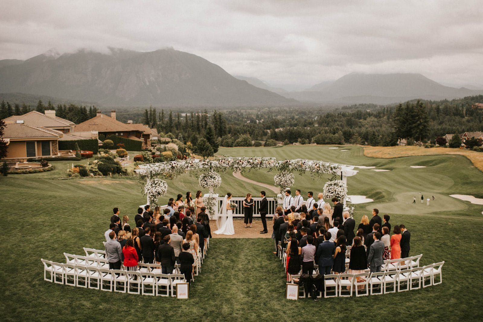 wide shot of ceremony at club at snoqualmie ridge wedding