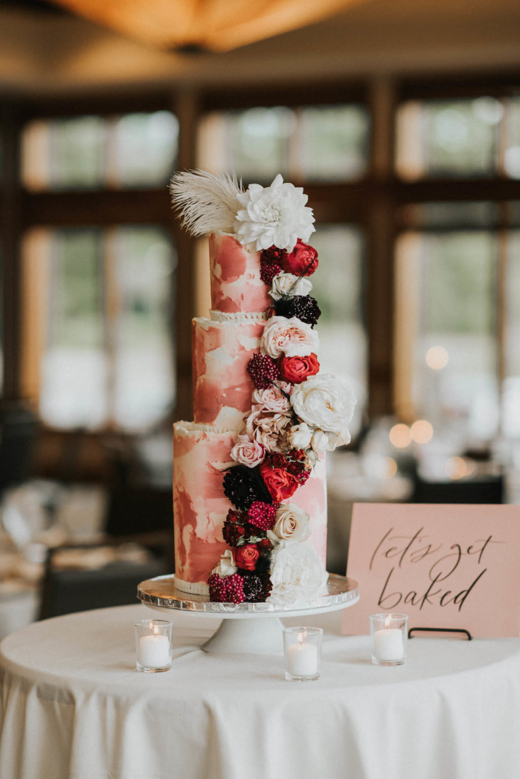 pink and white cake at the reception
