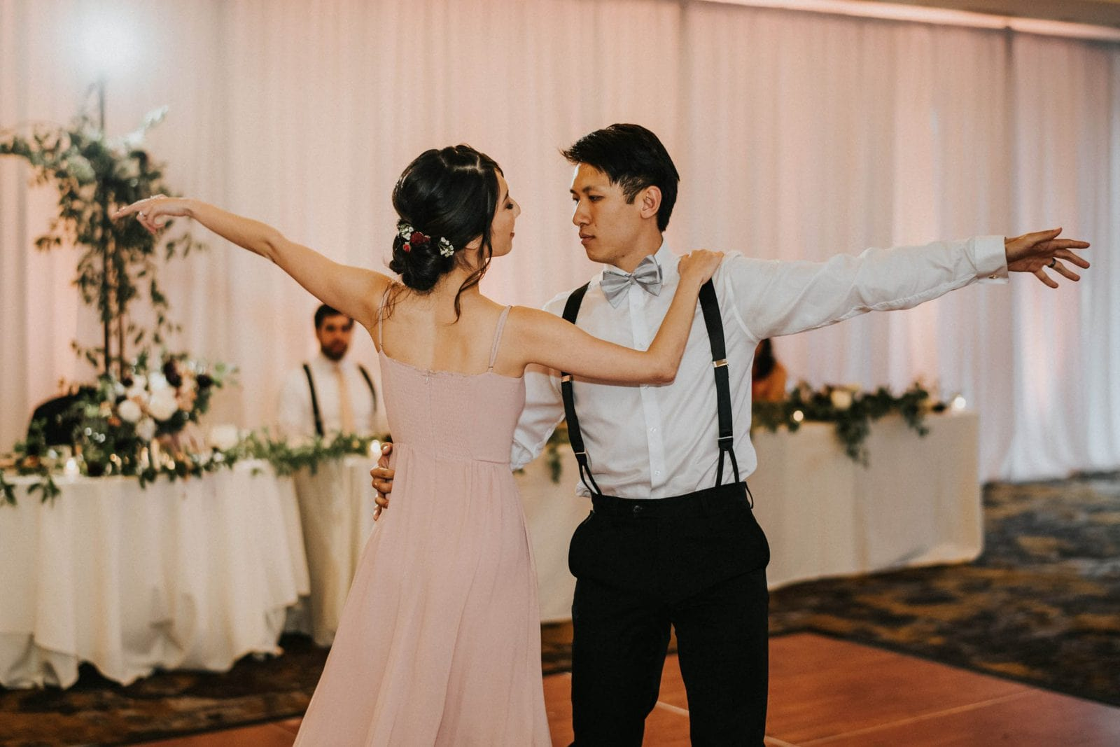 closeup of bride and groom dancing at reception