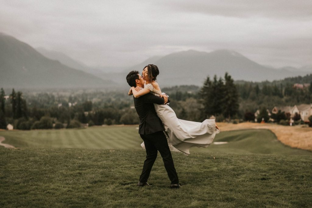 groom spinning bride around at club at snoqualmie ridge wedding