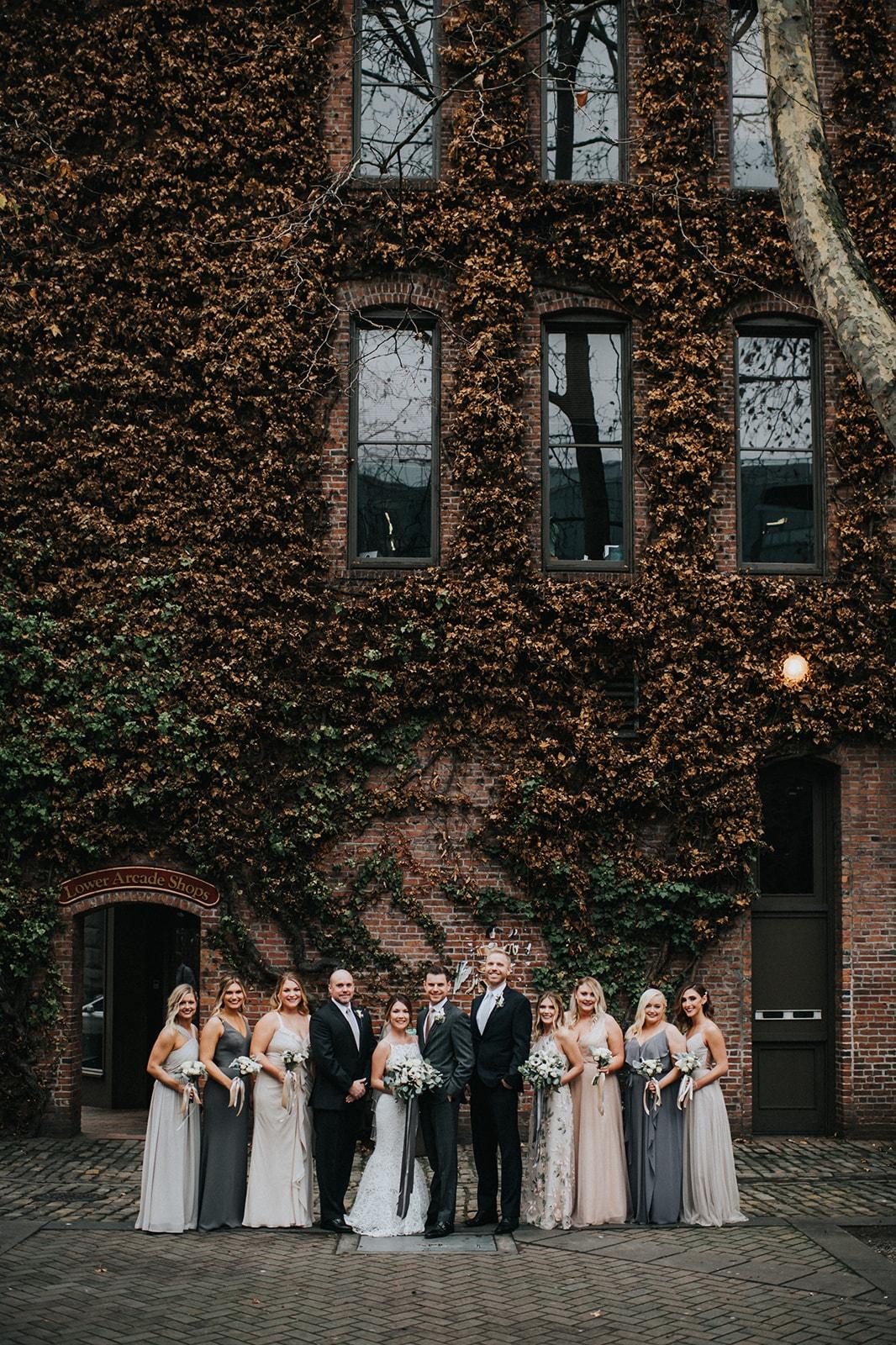 wedding party photos near axis pioneer square wedding venue