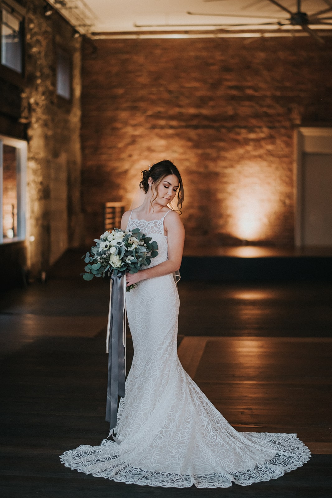 bride portraits inside axis pioneer square wedding venue