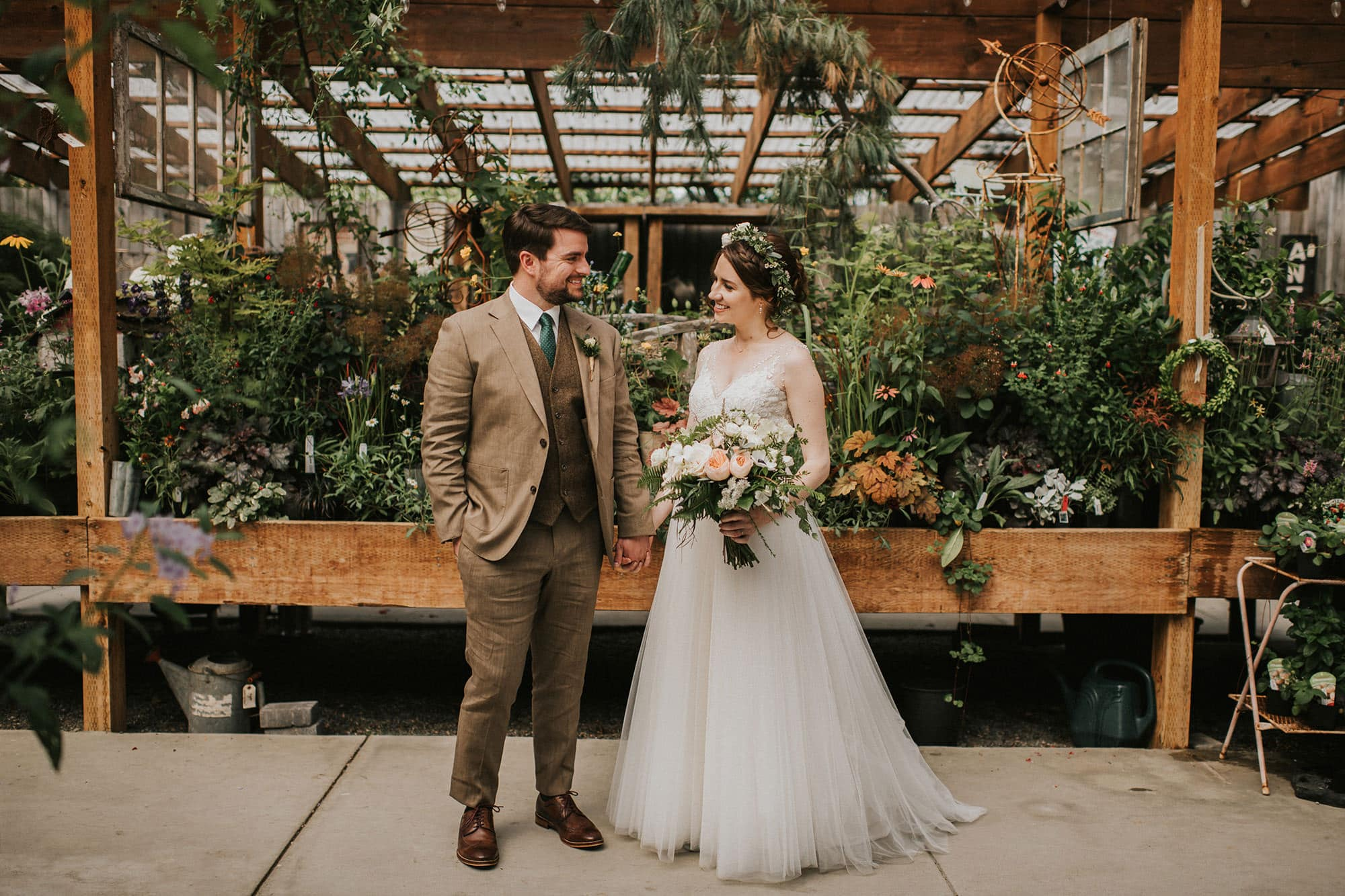 bride and groom greenhouse portraits at pine creek farms and nursery