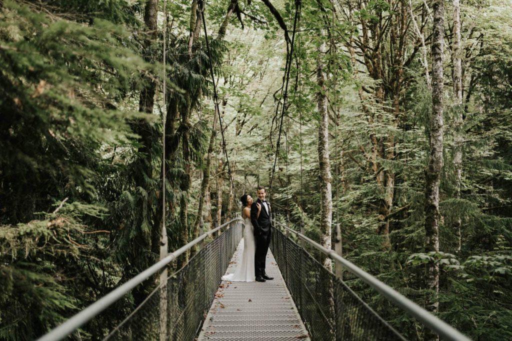 bride and groom on suspension bridge at at Islandwood bainbridge island