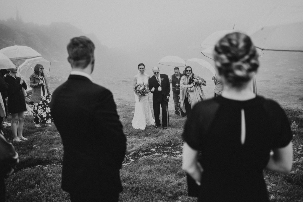 black and white of dad walking bride down the aisle