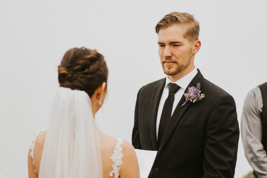closeup of groom looking at the bride