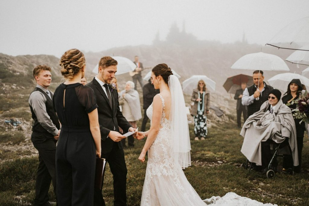 groom reading his vows to bride