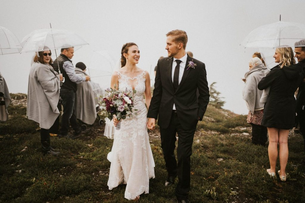 bride and groom walking away after ceremony at their artist point elopement