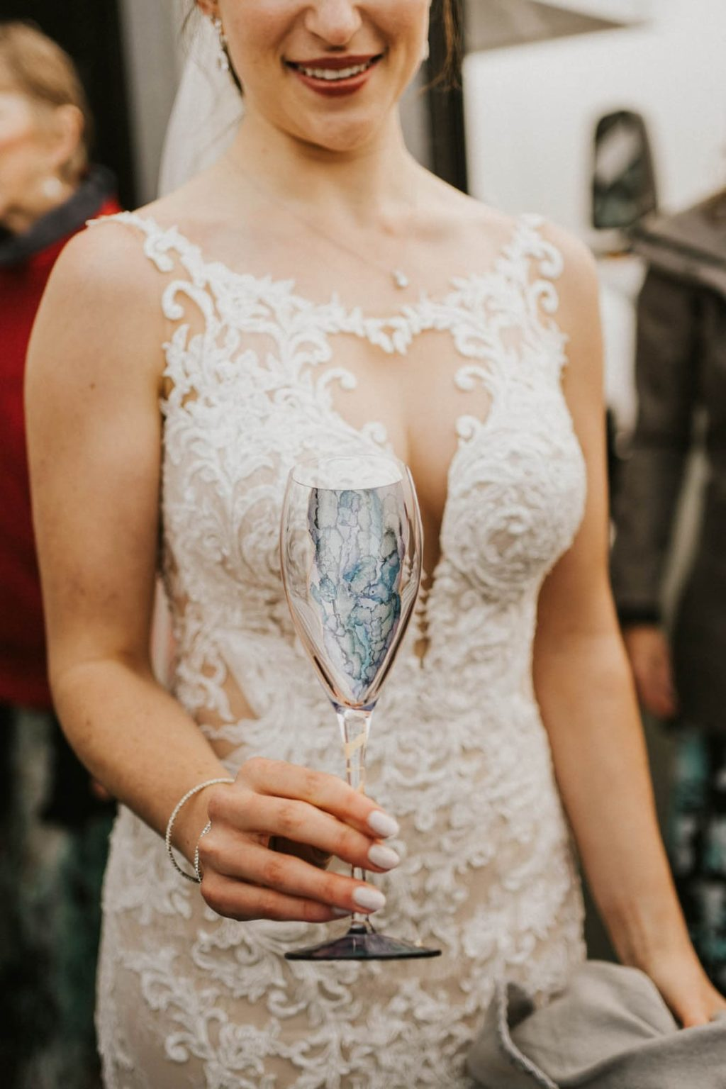 bride holding champagne glass