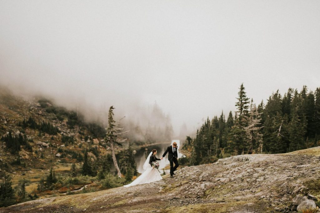 bride and groom walking at artist point elopement