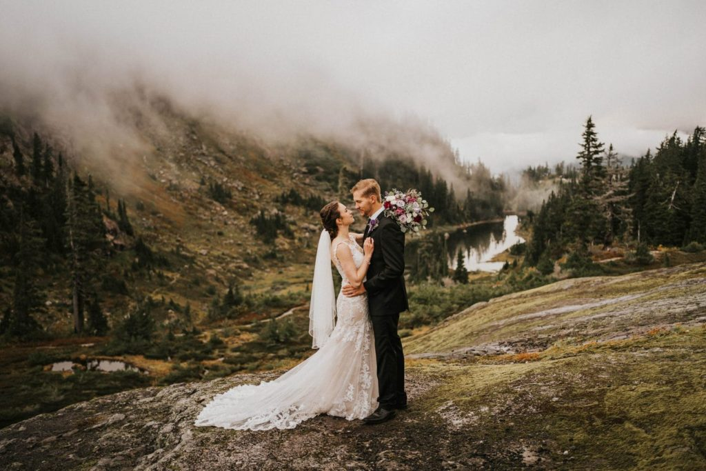 bride and groom looking at each other at artist point elopement