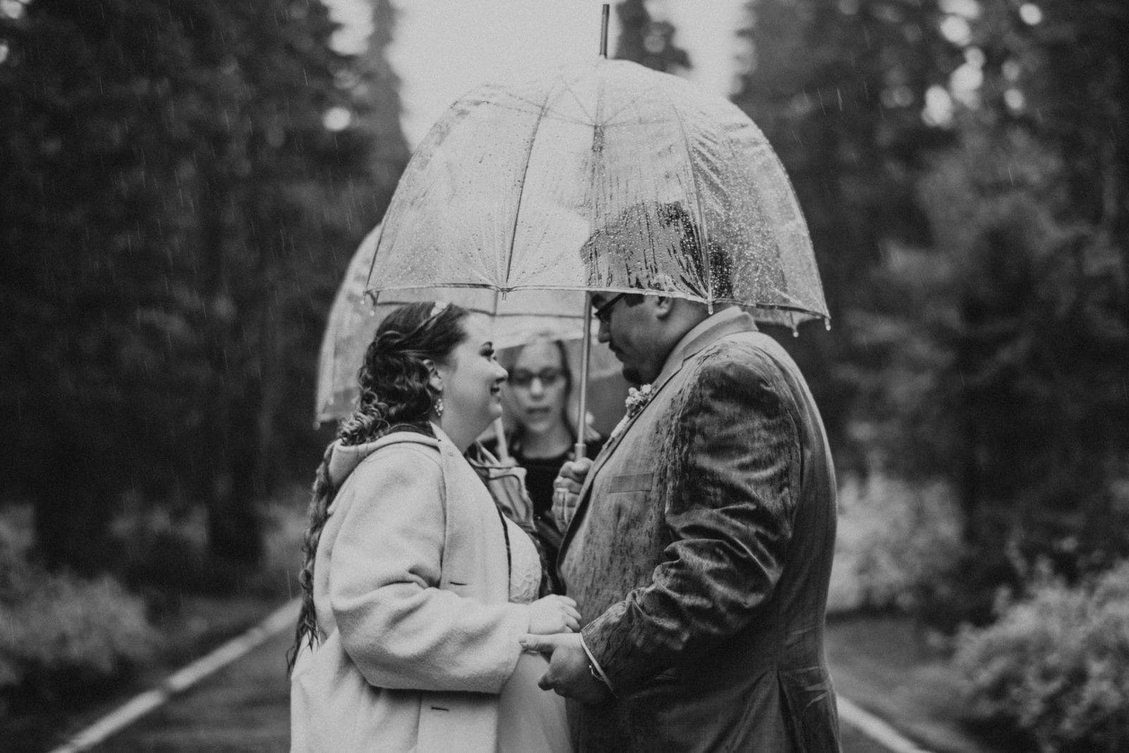 black and white of bride and groom at ceremony