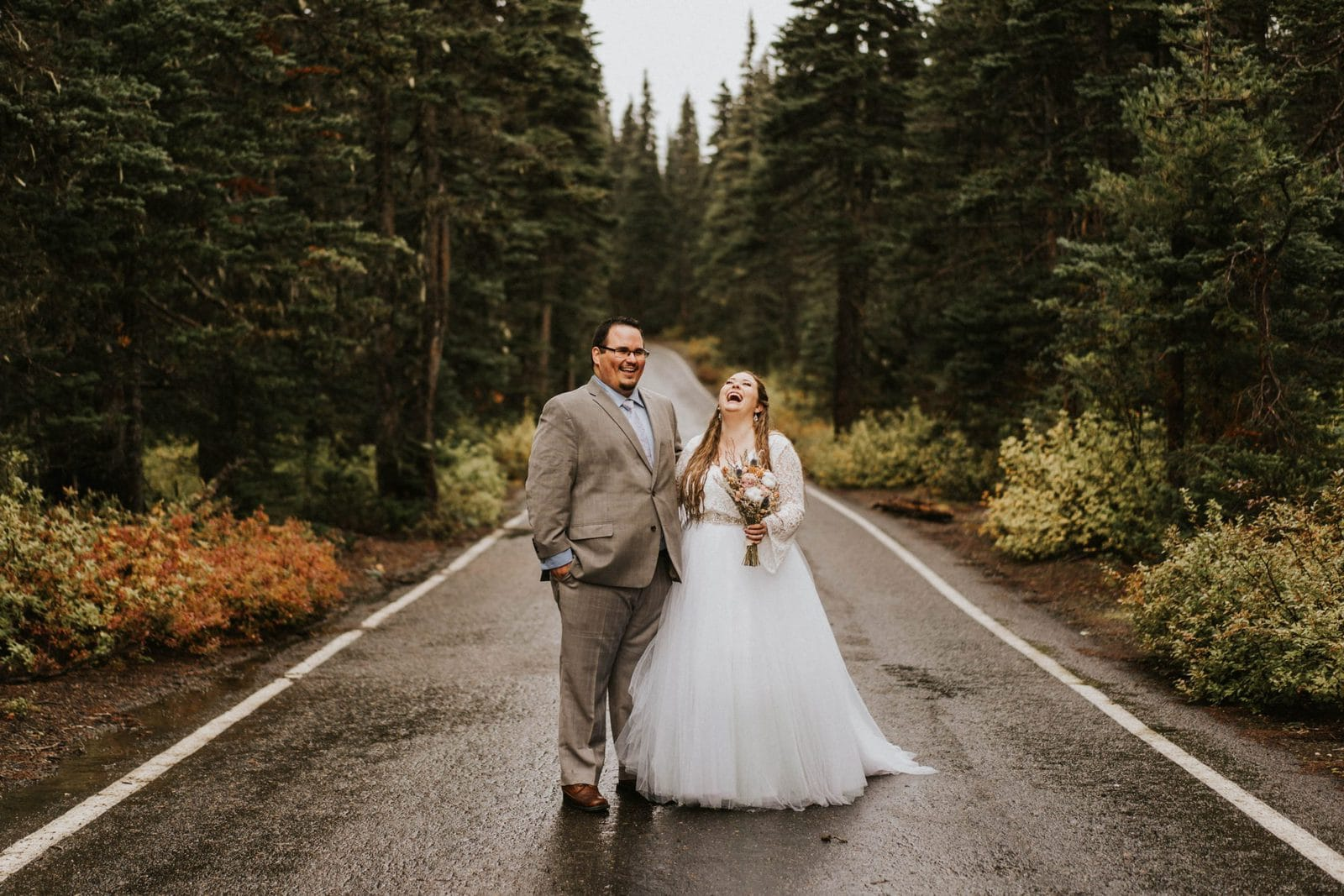 bride and groom laughing during road portraits