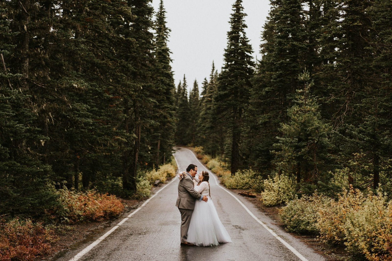 bride and groom in the road
