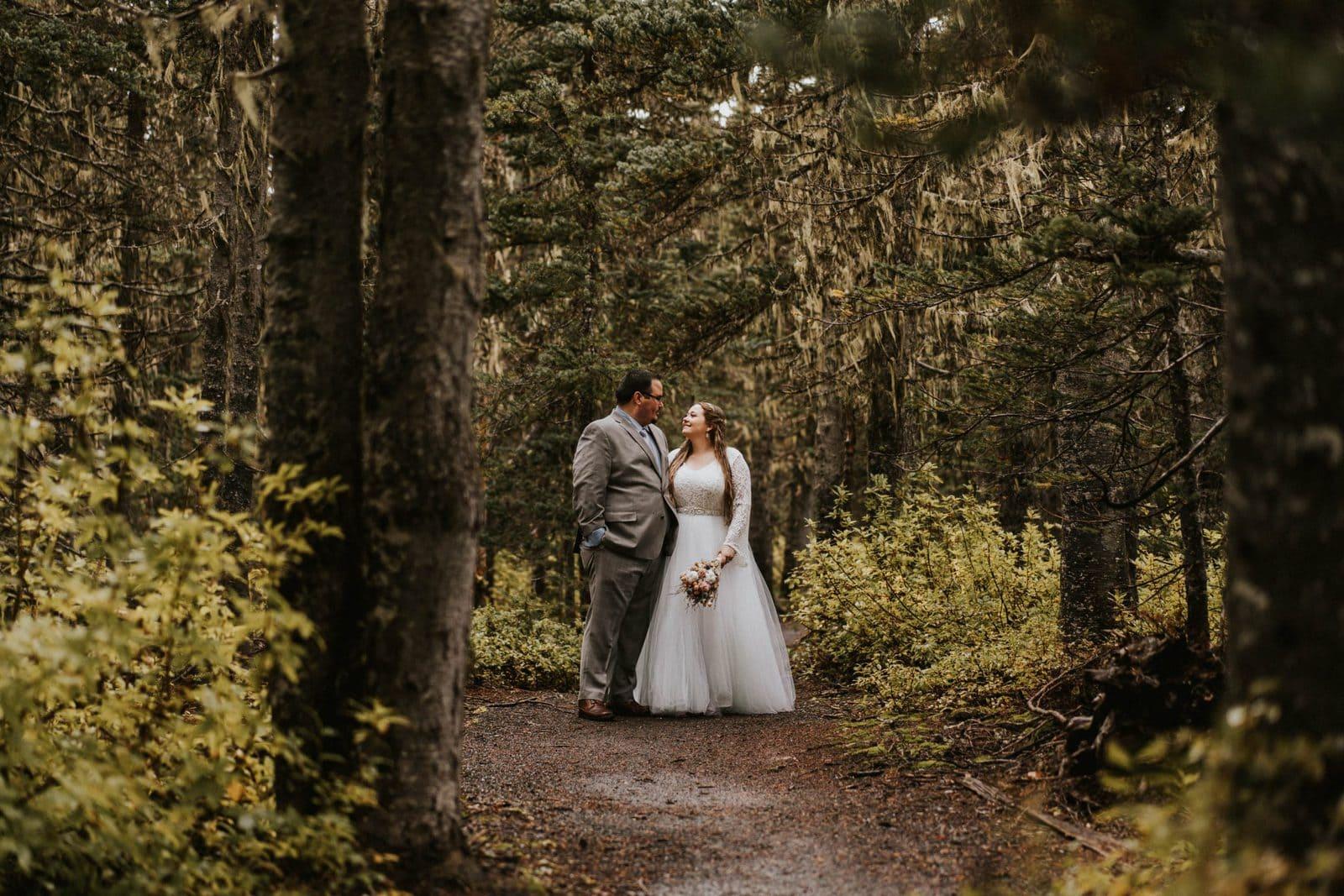 bride and groom posing in the woods