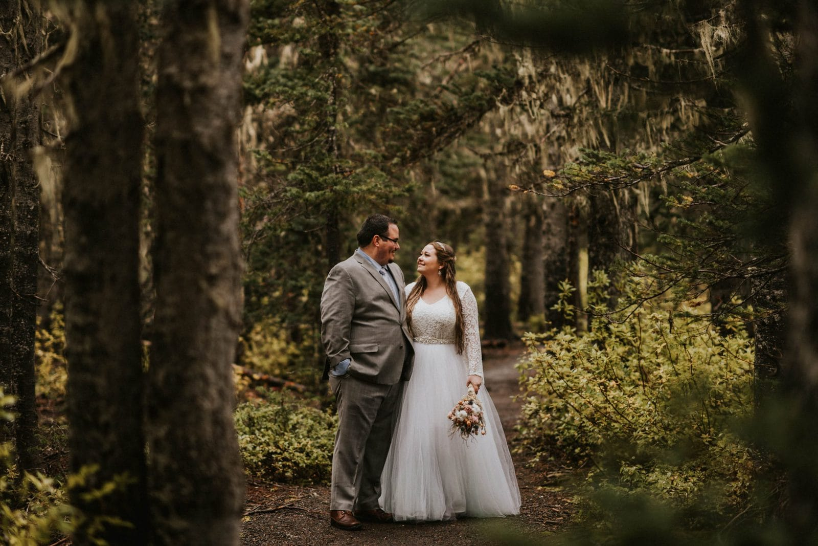 closeup of bride and groom in the woods